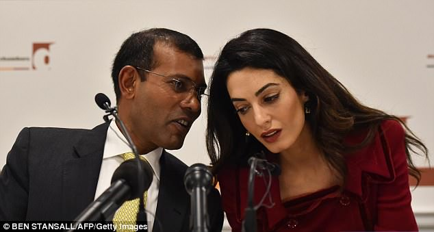 British lawyer Amal Clooney seen here listening to Former Maldives president Mohamed Nasheed during a press conference in London in 2016