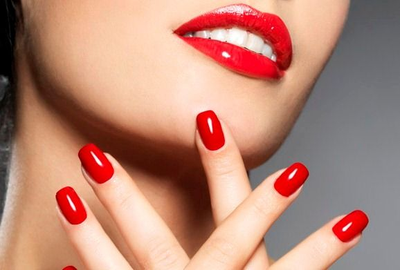 woman with fashion red nails and sensual lips